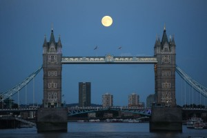 A supermoon rises over Tower Bridge in London